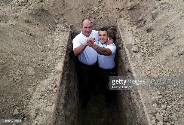 Gravediggers, Robert Szakaly and Rudolf Kecskemeti celebrate after winnig the 4th Hungarian grave digging championship on September 7, 2019 in...