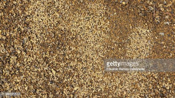 gravel and golden earth of a color similar to gold - gravel stock pictures, royalty-free photos & images