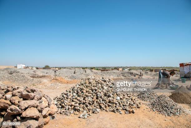 Gravel and other building materials are seen at a quarry in Kolwezi on April 24 2018 The historical battle of Kolwezi was fought in May 1978 by...