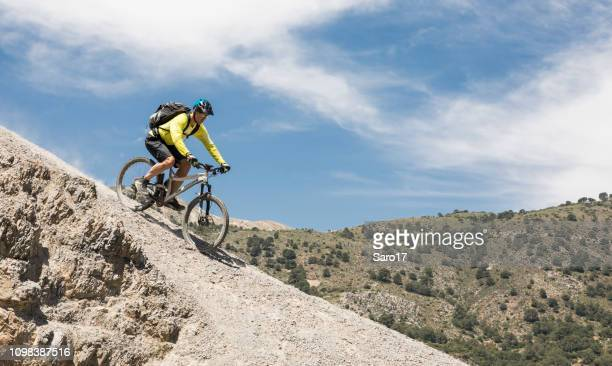 gravel downhill at andalucian sierra nevada, spain. - steep stock photos and pictures