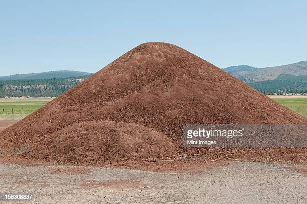 Gravel heap on the roadside, for construction and maintenance.