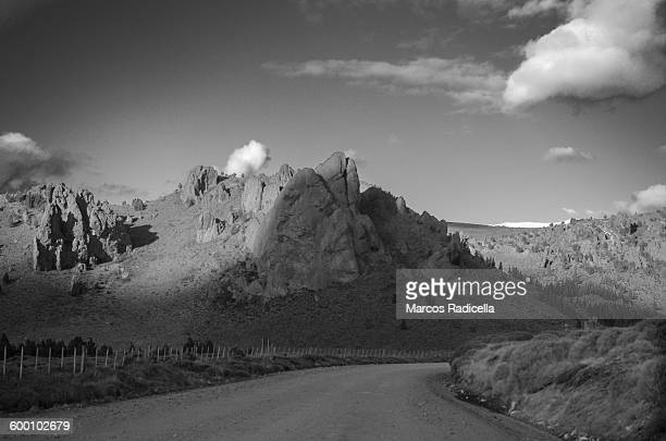 gravel road at patagonia - radicella stock photos and pictures