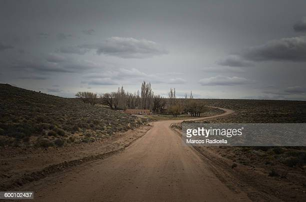gravel road at patagonian steppe - radicella stock pictures, royalty-free photos & images