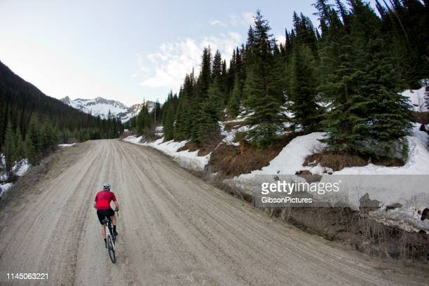 gravel road bicycle rider - sports jersey stock pictures, royalty-free photos & images