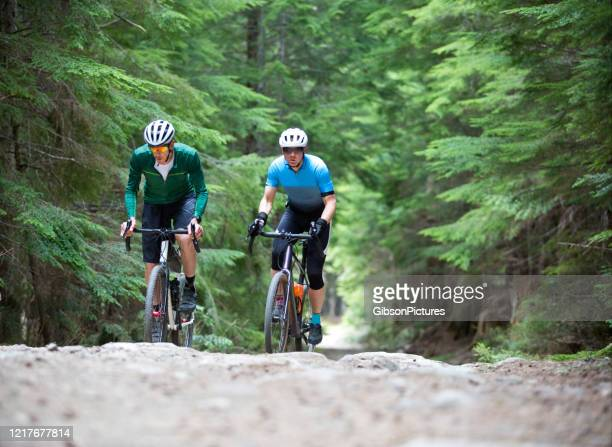 gravel road bicycle riders - gravel stock pictures, royalty-free photos & images