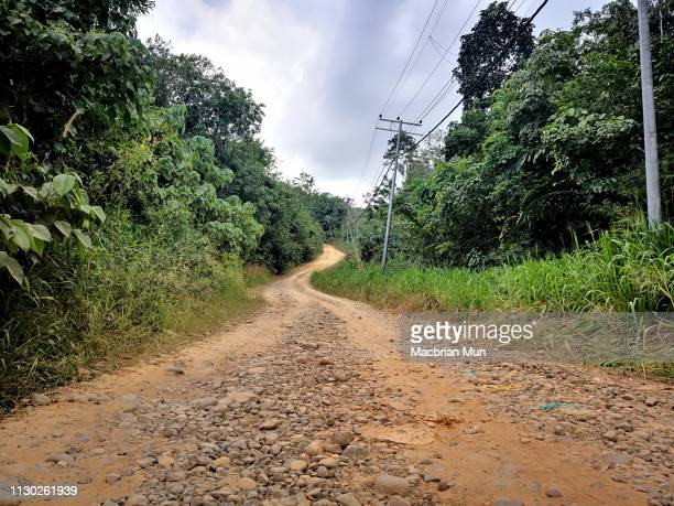 gravel road in a rural area - extreme terrain stock pictures, royalty-free photos & images