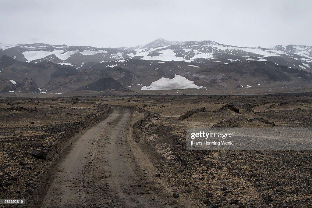 Gravel road in Iceland's volcanic highland : Stock Photo