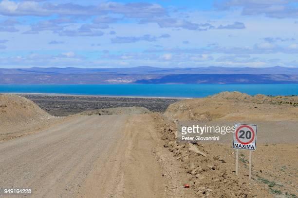 Gravel road Ruta 40 with speed limit 20 Km/h, behind Lago Cardiel and Andes, near Perito Moreno, province Santa Cruz, Patagonia, Argentina