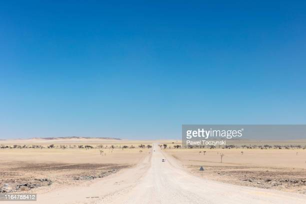 gravel road through namib-naukluft national park in erongo region, namibia, 2018 - namib naukluft national park stock pictures, royalty-free photos & images