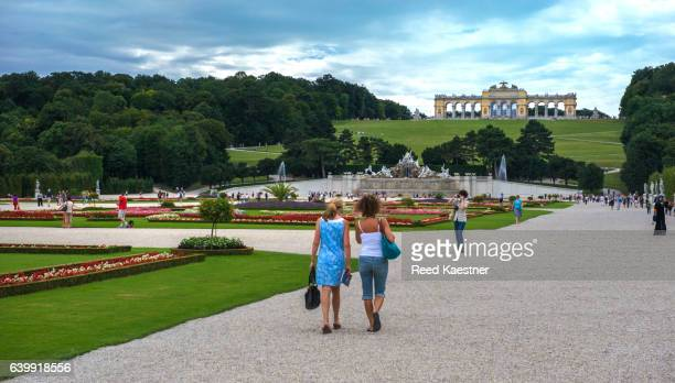 A gravel walkway surrounds the formal gardens at Schönbrunn Palace, Vienna, Austria