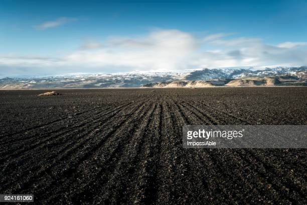 gravel way and the mountain range behind, Iceland