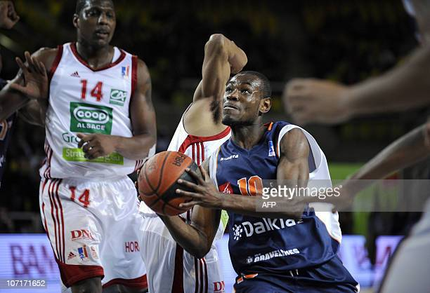 GravelinesDunkerque's Yannick Bokolo vies with Strasbourg's Pervis Pasco during their French ProA basketball match at the Rhenus stadium in...