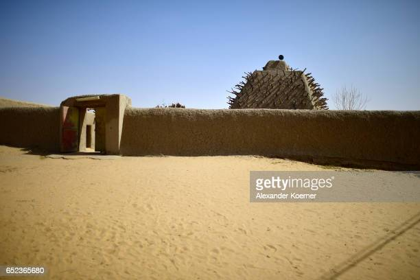 Graves are pictured next to the grave of Askia which was built in the 15th century in honor of King Mohammed I Toureon at the outskirts of Gao on...