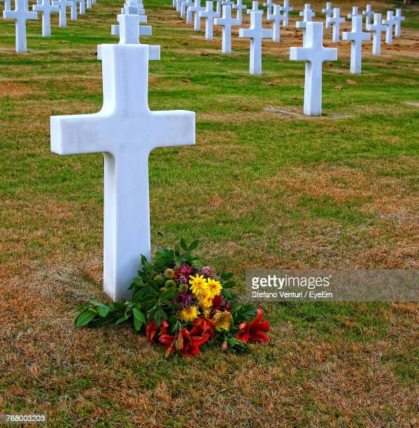 graves at cemetery - crosses with flowers stock pictures, royalty-free photos & images