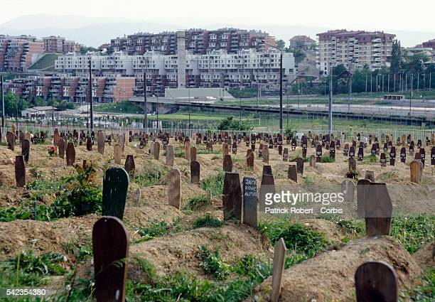 Graves begin to fill a huge field in a Sarajevo cemetery as numbers of people killed in the Yugoslavian Civil War increase Cemetery overflows on the...