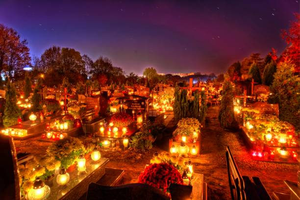Graves in a sea of candlelight