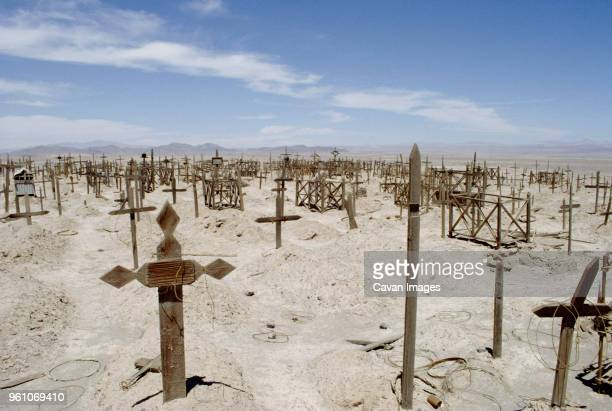 graves in cemetery against sky on sunny day - place of burial stock pictures, royalty-free photos & images