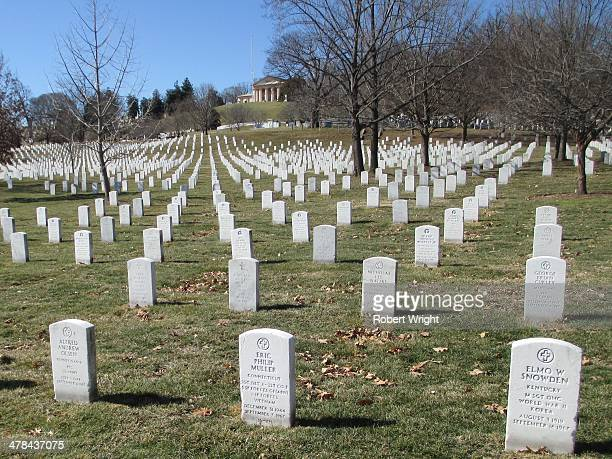 Graves of fallen US service personnel and their family members cover a hillside at Arlington National Cemetery - the US's national cemetery for...