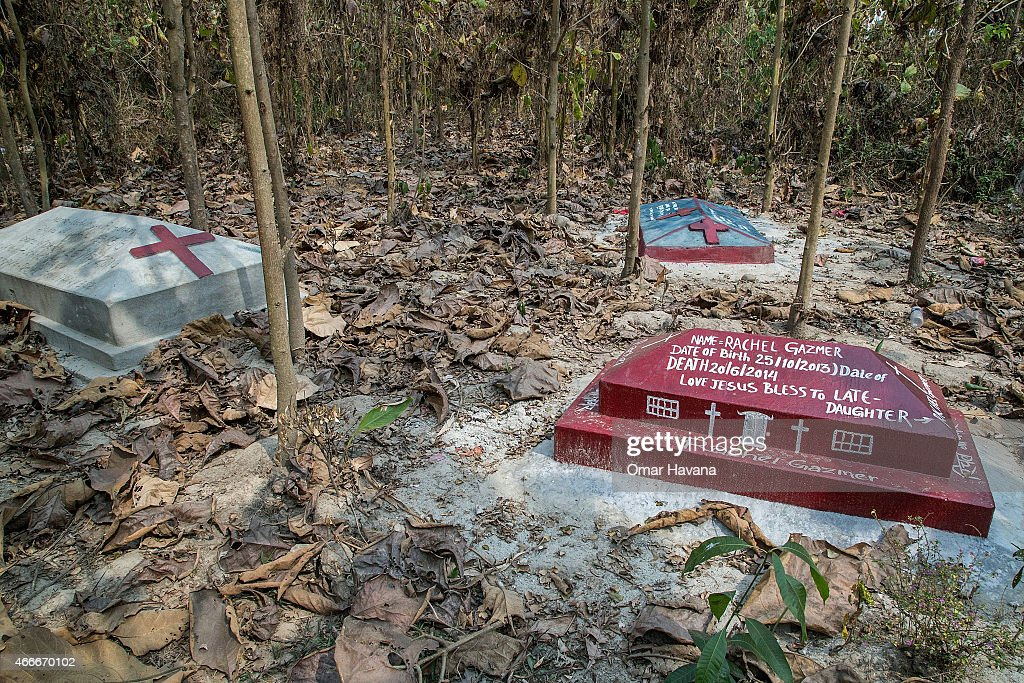 Graves of refugees that have died in the camp are located in the forest surrounding the Beldangi 2 refugee camp on March 14, 2015 in Beldangi, Nepal. Bhagimaya arrived 23 years ago in the camp. Different religions are practiced in the camp, with Buddhism, Hinduism, Kirali tribal and catholicism being the most followed. More than 22,000 Bhutanese refugees still reside in the refugee camps set up in Nepal in the 1990s, after hundreds of thousands of Bhutanese fled the country following a campaign of ethnic cleansing by the Bhutanese Government against the country's ethnic Nepali population. After more than 20 years in Nepal, over 90% of the refugees have been successfully resettled in third countries, thanks to programs by UNHCR and IOM. Those remaining the camps are supported by several organizations that undertake a wide variety of projects. Helped by remittances sent back to Nepal by families already resettled in other countries, the refugees still in the camps have set up their own small businesses in the camps and the roads near them, roads which are also replete with Nepali-owned businesses who benefit directly from the refugees that are still waiting in Nepal to be resettled in third countries.