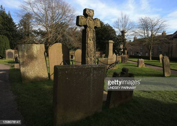 Graves of those who lost their lives in the 17th century Great Plague are seen in the village of Eyam in Derbyshire northern England on March 23 2020...