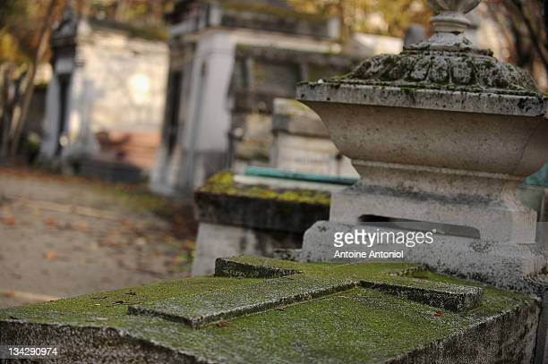 Graves stand at the Cimetierre du Pere Lachaise on November 29 2011 in Paris France