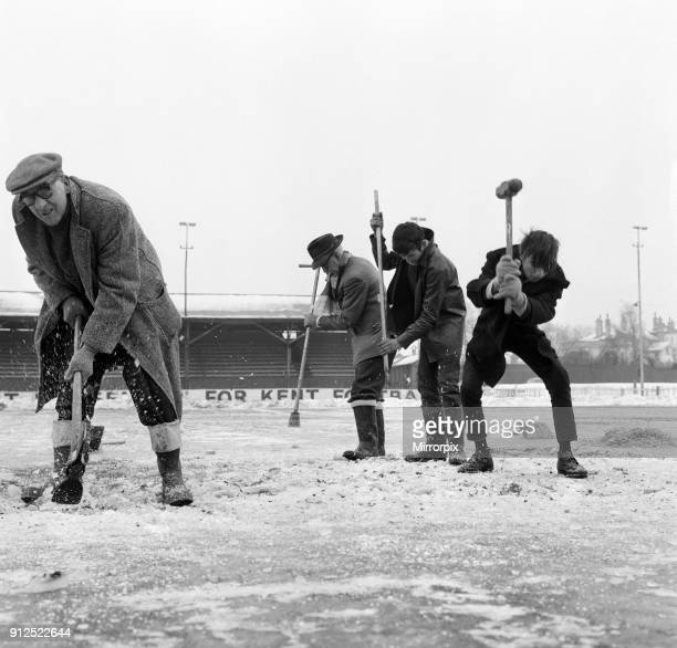 Gravesend and Northfleet training session in the snow ahead of their FA Cup fourth round match against Sunderland Pictured are workmen trying to...