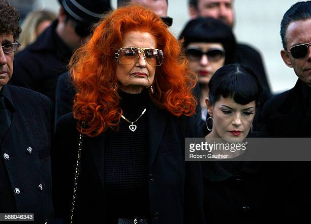 Graveside at the Bettie Page funeral are Tempest Storm left and Bernie Dexter Storm is a famous stripper/model who starred in the 1950 movie...