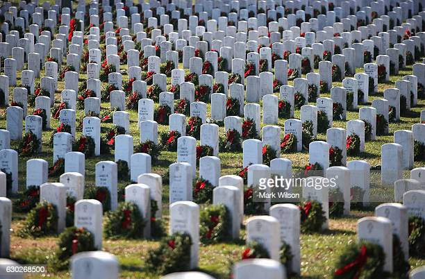 Gravesites are decorated by friends and family for the holiday season at Section 60 at Arlington Cemetery December 19 2016 in Arlington Virginia...