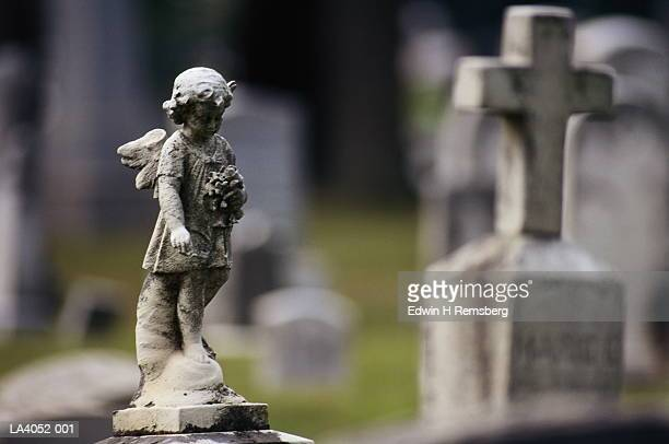 gravestones and statues in cemetery, close-up - grabmal stock-fotos und bilder