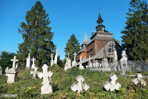 Gravestones dot an old cemetery near the Church of the Descent of the Holy Spirit in Rohatyn IvanoFrankivsk western Ukraine September 5 2019 The...