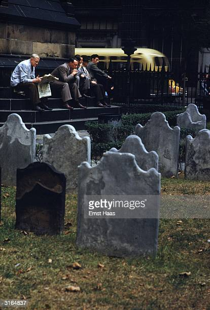 Gravestones in a church yard provide a quiet spot in Wall Street for city workers to snatch a peaceful moment