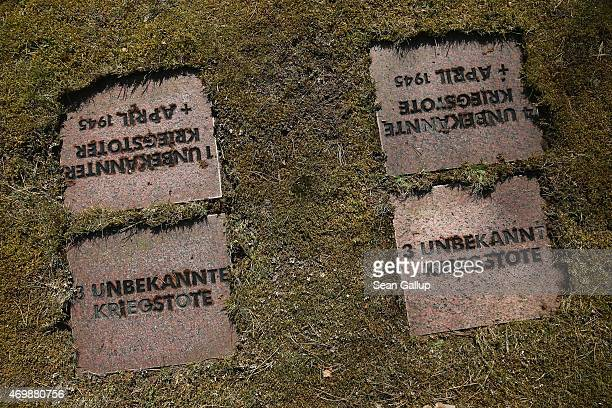 Gravestones including one whose inscription reads Three unidentified war dead lie at the German war cemetery and memorial where tens of thousands of...