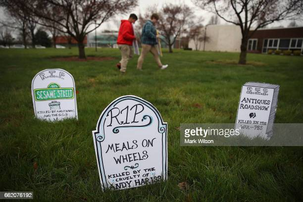 Gravestones representing PBS Television shows that would be affected by President Donald Trump's budget proposel are placed on the ground where...