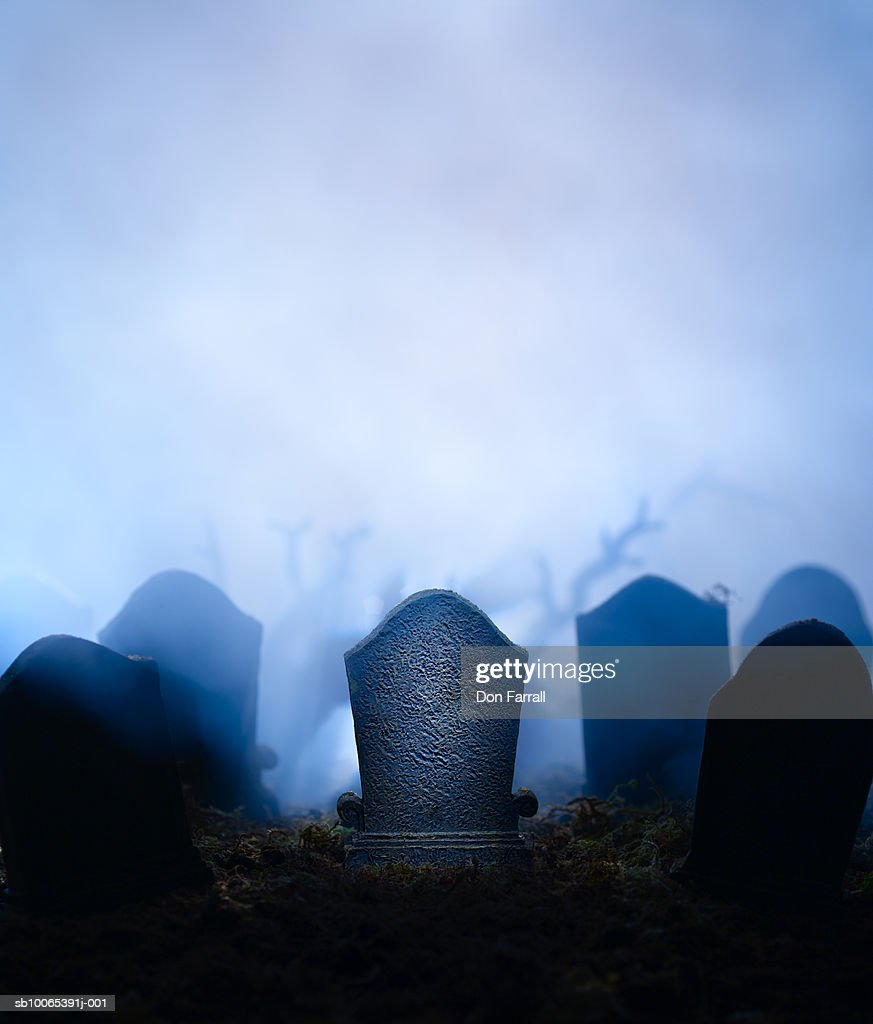 Graveyard at night with graves in mist : Foto stock