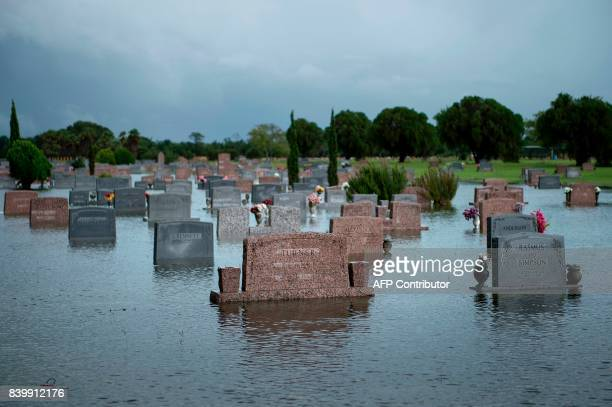 TOPSHOT A graveyard is seen as it floods during the aftermath of Hurricane Harvey August 27 2017 in Pearland Texas Hurricane Harvey left a trail of...