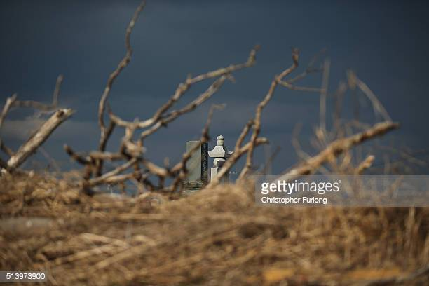 A graveyard stands in the tsunami scarred landscape inside the exclusion zone close to the devastated Fukushima Daiichi Nuclear Power Plant on...