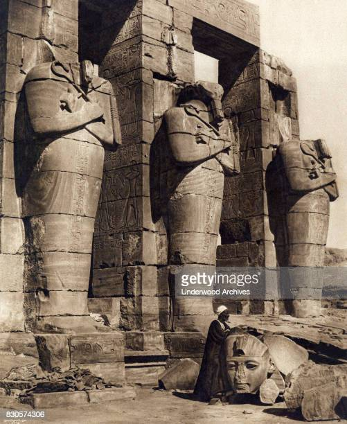 A gravure of the Osiride statues at the entrance to the Ramesseum the memorial temple of Pharaoh Ramesses II Thebes Egypt circa 1905 Original...