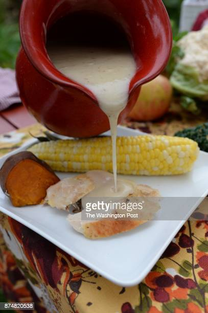 Gravy over roasted chicken with sweet potato and corn on the cob for dinner at Lisa King's home in Butler PA on October 15 2013 The Kings are stars...