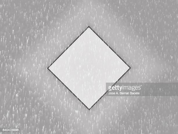 Gray background made up of colorful water drops floating in the air with a rhombus shape
