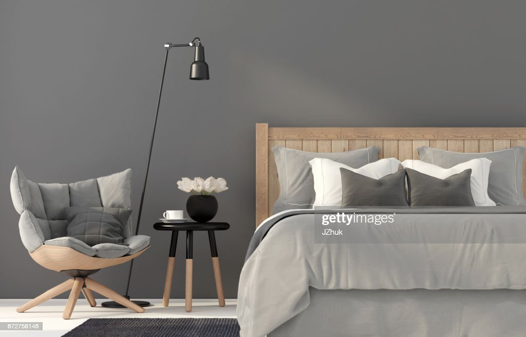Gray bedroom with a wooden bed : Stock Photo