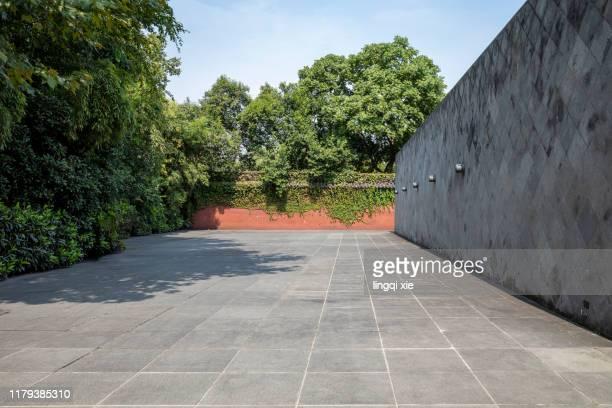 gray brick wall and ground at west lake, hangzhou, china - 市街地の道路 ストックフォトと画像