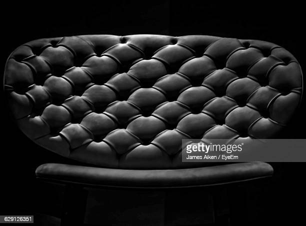 gray chair against black background - aikāne stock pictures, royalty-free photos & images