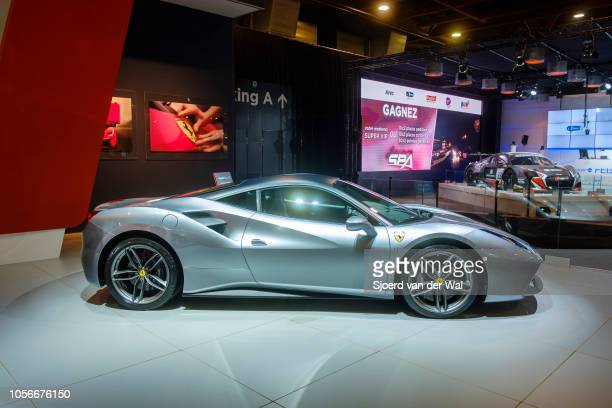 Gray Ferrari 488 GTB coupe sports car side view on display at Brussels Expo on January 10 2018 in Brussels Belgium The Ferrari 488 GTB is a...
