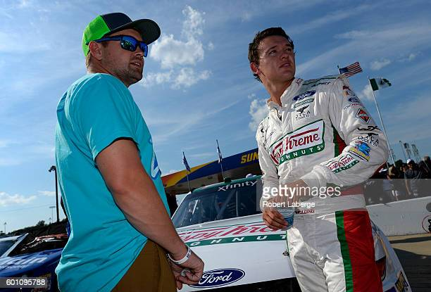 Gray Gaulding driver of the Krispy Kreme Ford talks with Ricky Stenhouse Jr driver of the Zest Ford during qualifying for the NASCAR XFINITY Series...