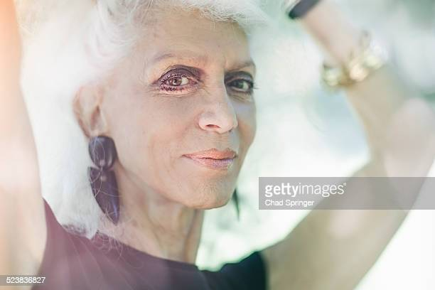 Gray haired woman smiling with confidence