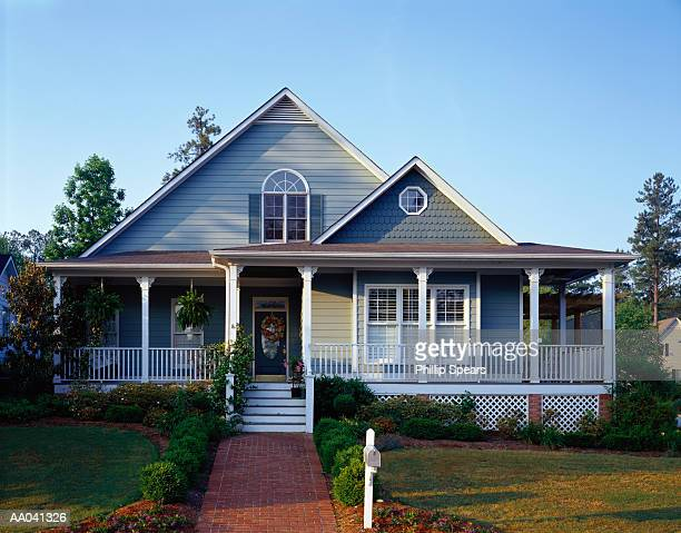 gray house with wraparound porch, exterior - stereotypically middle class stock pictures, royalty-free photos & images