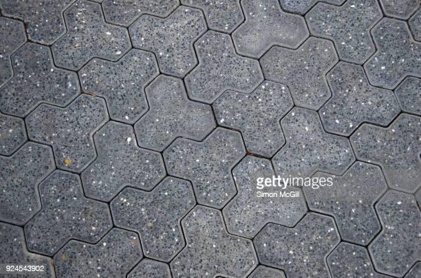 Gray interlocking paving stones on a public footpath