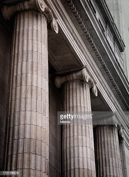 gray ionic columns at the front of a traditional building - column stock pictures, royalty-free photos & images