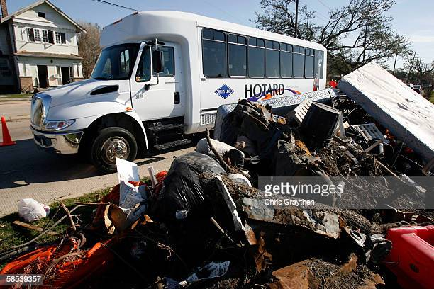 Gray Line Bus drives past a pile of debris in the Lakeview Area as part of a new tour showing areas devastated by Hurricane Katrina on January 7 2005...