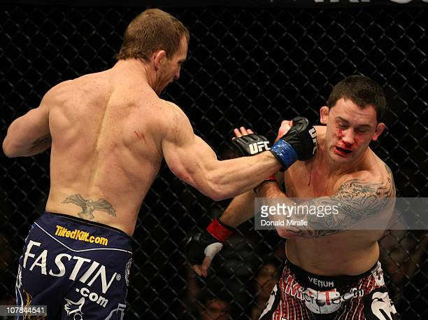 Gray Maynard punches Frankie Edgar at UFC 125 Resolution at the MGM Grand Garden Arena on January 1 2011 in Las Vegas Nevada